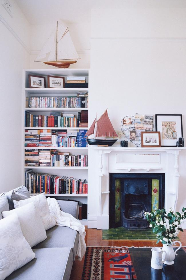 In this Ballarat home, the owners' love of books, vintage travel pieces and sailing line the shelves and the fireplace mantel.