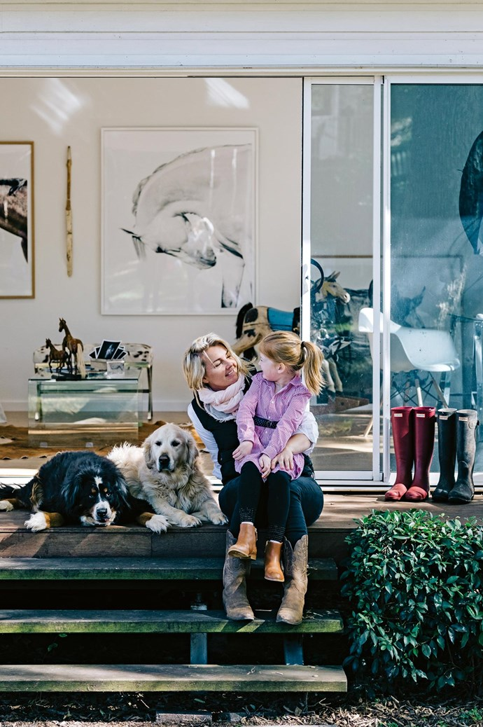 Katie and Isobel in front of her light-filled studio, where she meets clients and edits her images. Her workspace sits in the backyard of her home.    Photo: Marnie Hawson