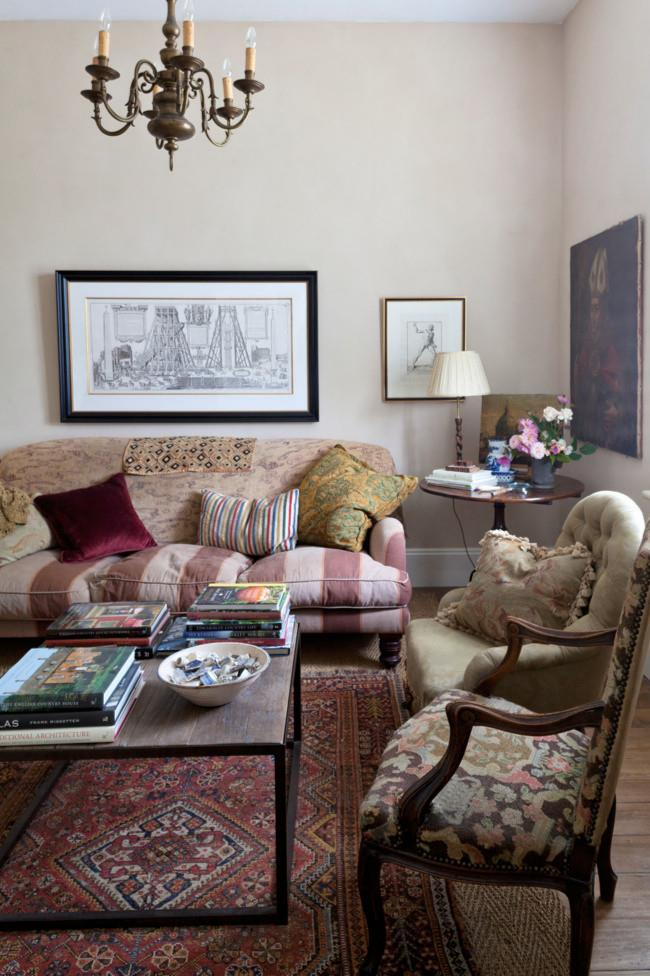 Mixing, rather than matching, is the secret to the warm, welcoming feel of this cottage living room. Fabrics in florals, solids, stripes and patterns create a sense of accidental harmony, alongside engravings bought in Italy and a chandelier from Tasmania.