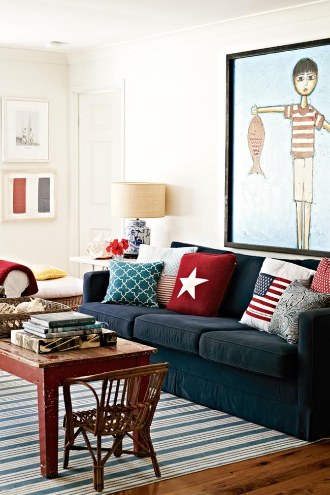 Taking its cue from its coastal location on Stradbroke Island, the living room of the holiday home exudes a cool, casual feel. Calming blues contrast with hits of confident red against the white walls, while nautical stripes add interest and a fresh, crisp feel.