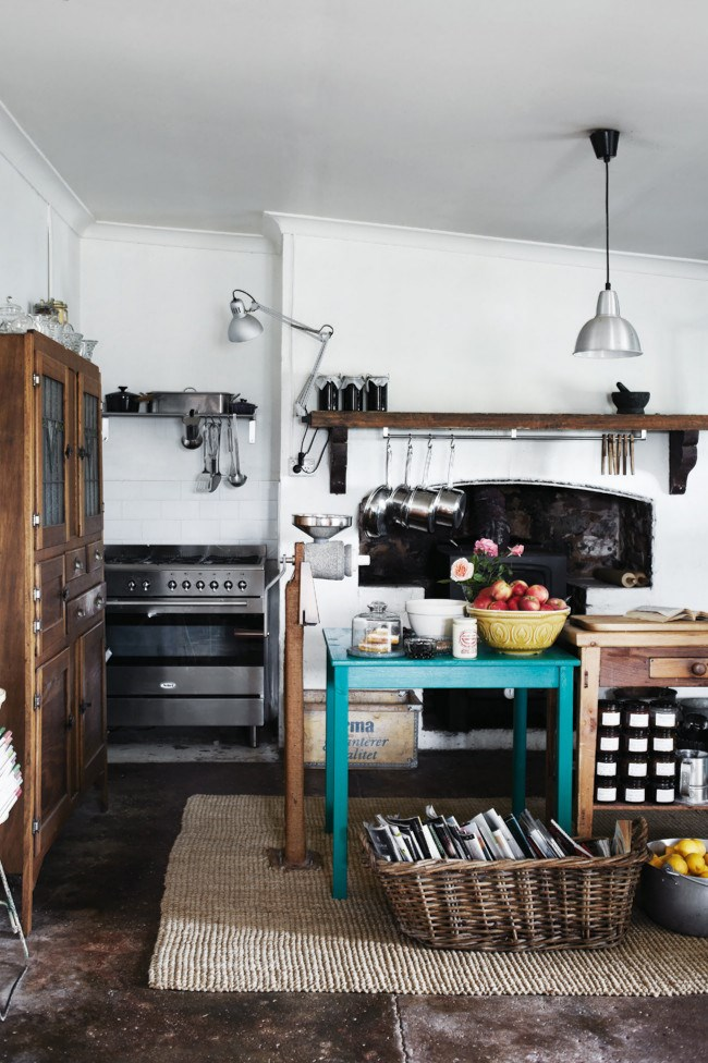 """In a [160-year-old cottage in the Barossa Valley](http://www.homelife.com.au/country-style/lovingly-restored-160-year-old-farmhouse-in-the-barossa-valley-south-australia?ref=/search), the original kitchen mantelpiece and concrete floor have been retained. Concrete is a versatile kitchen option, available in a range of finishes from smooth and shiny to a softer mottled look. If you're intrigued by the idea, investigate the concrete flooring information at [Boral](http://www.boral.com.au/concrete/concrete.asp target=""""_blank"""" rel=""""nofollow""""). *Photo: Sharyn Cairns*"""