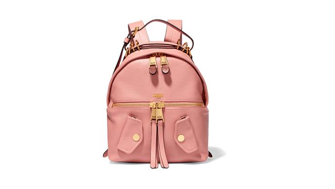 The Urban Sophisticate In baby pink textured leather, this backpack is studded with fashionable details borrowed by a biker jacket. Moschino backpack; [net-a-porter.com](https://www.net-a-porter.com/au/en/)