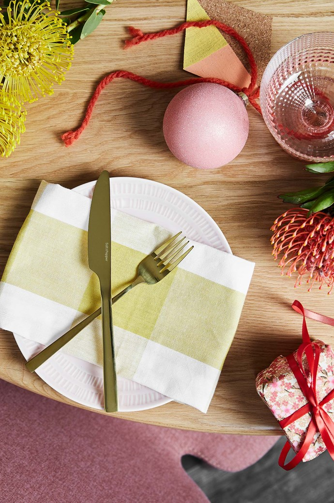 "WHAT'S ON THE MENU: An amazing cheese platter gets the party started, followed by ham with all the trimmings and this baked ricotta and orange blossom pie to finish. TIPS FOR ACHIEVING THIS LOOK: ""Summer and Christmas are a fun, celebratory time of year so playing with different colours like pink and warm terracotta adds a sense of playfulness to your Christmas meal,"" says Allira. ""Centrepieces don't need to follow a traditional formula either – here we've used a potted succulent as our base and added bright native flowers and wrapped presents to make a feature."" 