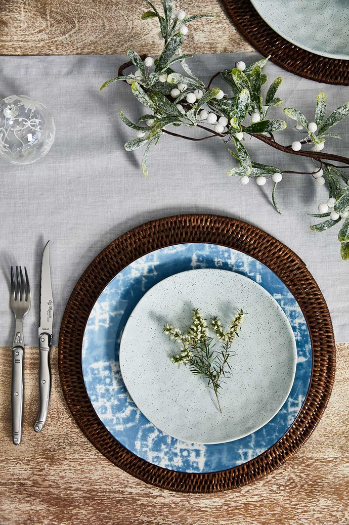 "WHAT'S ON THE MENU: Fresh prawns, delicious smoky paprika scampi, bright summer salads and rolled pavlova. TIPS FOR ACHIEVING THIS LOOK: ""Adding some formality to this relaxed coastal setting keeps it from looking messy,"" says stylist Allira Bell. ""Use a placemat to ground each setting and layer your dinnerware for a more cohesive look. Even if you love a traditional table, it doesn't need to be stuffy – a bench allows for extra guests and adds a sense of togetherness – just make sure everyone is comfortable with some cushions.""  