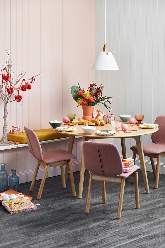 2\. BRIGHT BANQUET: For the fun-loving group of friends and family who are partial to Fleetwood Mac and a good bottle of red wine. Warm-toned and playful, this setting features Scandi furniture, native flowers and pops of terracotta. WHAT'S ON THE TABLE: Native florals take centre stage in this setting, surrounded by a simple dinner set and bright, colourful glassware. [Gold cutlery](https://www.templeandwebster.com.au/16-Piece-Gold-Host-Cutlery-Set-42909-SALT1021.html?sku=SALT1021&event_id=10543) adds a tasteful touch while gifts wrapped in mustard and tangerine tones and a rose-gold tree adorned with pom poms complete this playful space. | Photo: Temple & Webster