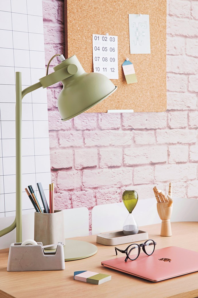 Ingrid + Mika 'Contact Grid 55' wallpaper, $132 for 10m, from [Milton & King](https://www.miltonandking.com/). Rebel Walls 'Soft Bricks Pink' wallpaper, $76 a square metre, from [Scandinavian Wallpaper & Décor](http://www.wallpaperdecor.com.au/). Oyoy cork noticeboard, $80, from [Leo & Bella](https://leoandbella.com.au/). Calendar and pins, sylist's own. Harto 'Victor' desk in White, $1295, from [Clickon Furniture](https://www.clickonfurniture.com.au/). 'Shift' table lamp in Pistachio, $289, from [Città](https://www.cittadesign.com/). Areaware concrete desk set in Grey, $99.95, from [Until](http://www.until.com.au/). Katie Leamon graphite pencils, $19.95 a set of 6, from [Milligram](https://milligram.com/). 'Time' hourglass in Grass Green, $43, and wooden hand sculpture, $43, both from [Hay](http://hay.dk/). Daily Fiction by Normann Copenhagen 'Letter' sticky notes, $9.95, from [BYMR](http://www.bymr.com.au/). MacBook laptop in Rose Gold, $1899, from [Apple](https://www.apple.com/au/). Glasses, stylist's own. | Photo: Chris Warnes