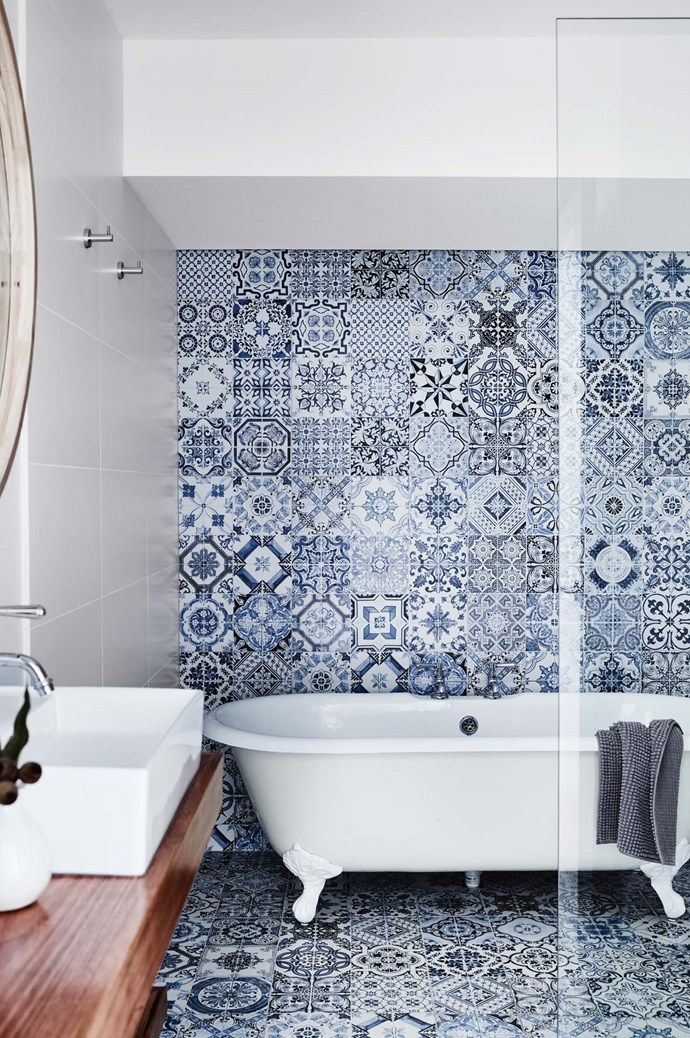 'Decorato Blue' tiles from [Lifestiles](https://www.lifestiles.com.au/) create a lavish look in the guest bathroom. The claw-foot bath is from [Schots Home Emporium](https://www.schots.com.au/), the 'Winslow Pillar' tapware is from [E&S Trading](http://www.eands.com.au/) and the cabinetry was custom-made in Gippsland timber 'Wormy Chestnut'. | Photo: Mark Roper