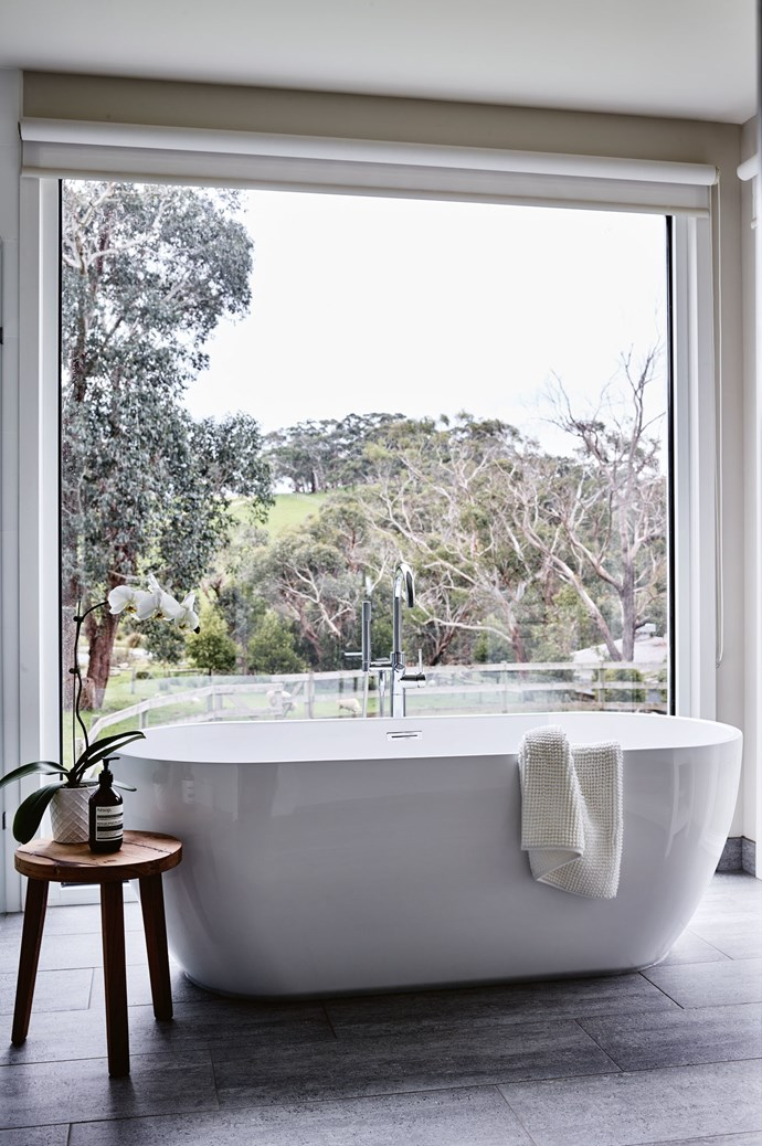 The 'Olsen' tub from [Schots Home Emporium](https://www.schots.com.au/) takes centre stage in the main bathroom, which boasts a view of the paddocks. | Photo: Mark Roper