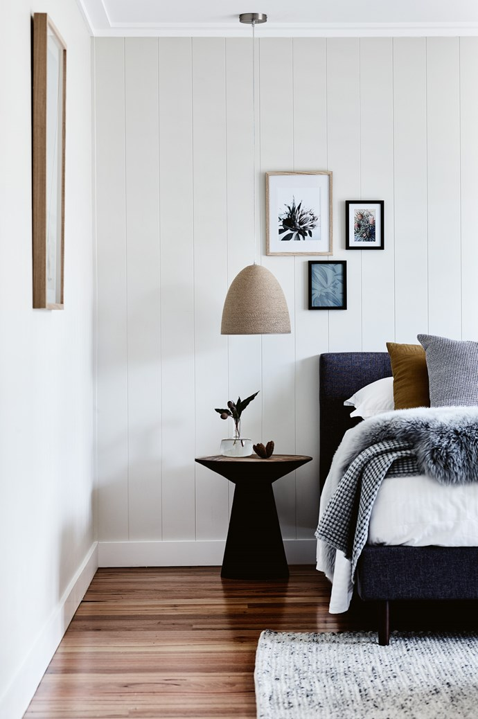 A 'Solomon' pendant light from [Bunnings](https://www.bunnings.com.au/) hangs in one of the guestrooms, over the 'Elanda' side table from [The Belle Bright Project](http://www.thebellebrightproject.com.au/). The linen 'Khaki Kick' pillow on the bed is by [Major Minor](https://majorminorwares.com/) and the grey pillow is from [Weylandts](https://www.weylandts.com.au/). A sheepskin from [Adairs](https://www.adairs.com.au/) adorns the bed and the rug is 'Skan' from Rugs Online. | Photo: Mark Roper