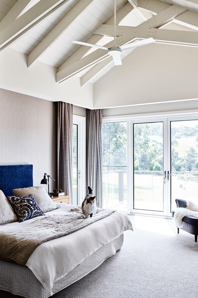 "The home is distinguished by features like vaulted ceilings with scissor trusses, as seen in the main bedroom. Kerry [made the bedhead](https://www.homestolove.com.au/5-creative-bedhead-ideas-to-inspire-5152|target=""_blank"") herself."