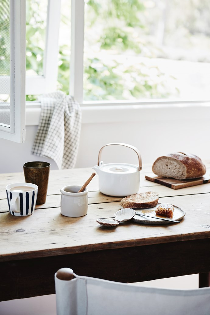 ON TABLE, FROM LEFT 'Boston' mug in Indigo/White, $9.95, from [Provincial Home Living](https://www.provincialhomeliving.com.au/). Brass lassi cup, $48, from [Imprint House](https://www.imprinthouse.net/). Ceramic honey pot, $59, and olivewood honey spoon, $20 from [Scout House](https://www.scouthouse.com.au/). Shell clasp, $15, from [Scout House](https://www.scouthouse.com.au/). Handmade ceramic plate by Lisa Peri, $25, from [Pépite](https://pepite.com.au/). 'Nigiri' knife, $19.95 a three-piece set, from [Hunting For George](https://www.huntingforgeorge.com/). Marimekko 'Oiva' teapot, $119, from [Angelucci](http://www.angelucci.net.au/). Timber breadboard, $20 from [Nook Vintage](https://www.instagram.com/nookvintage/). Tea towel in Black Check, $16, from [Imprint House](https://www.imprinthouse.net/). | Photo: Lisa Cohen