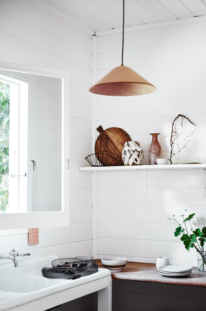 TOP LEFT Leather fly swat (on wall), $49 from [Scout House](https://www.scouthouse.com.au/). ON SINK Vintage French fishing trap, $65, from [Coastal Vintage](https://www.coastalvintage.com.au/). 'Amber' stripe bowl, $59.95, from [House of Orange](https://www.houseoforange.com.au/). Robert Gordon chai mug, $28, and 'Canvas' side plates, $28 each, all from [Southwood Home](https://www.southwoodhome.com.au/). 'Anchor' glass (as vase), $8.95, from [Scout House](https://www.scouthouse.com.au/). ON SHELF, FROM LEFT Wire gathering basket, $36, from [Imprint House](https://www.imprinthouse.net/). 'Flinders' breadboard, $78, from [Maison Est](http://maisonest.com.au/). Handmade ceramic vase by Anne-Marie Peters, $90, from [Pépite](https://pepite.com.au/). Vintage Italian amber vessel, $195, from [Angelucci](http://www.angelucci.net.au/). Ceramic vessel, $25 from [Zakkia](http://www.zakkia.com.au/). 'Loop' pendant light, $440, from [Barnaby Lane](https://barnabylane.com.au/). | Photo: Lisa Cohen