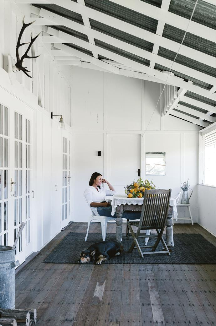 """I knew renovating the house was going to be a lot of work but I wanted it to be so beautiful that I'd never want to leave,"" Maree explains. She and her kelpie Louis relax on the verandah, which includes a table which belonged to her grandmother, laid with a tablecloth crocheted by Maree's mother Nora."