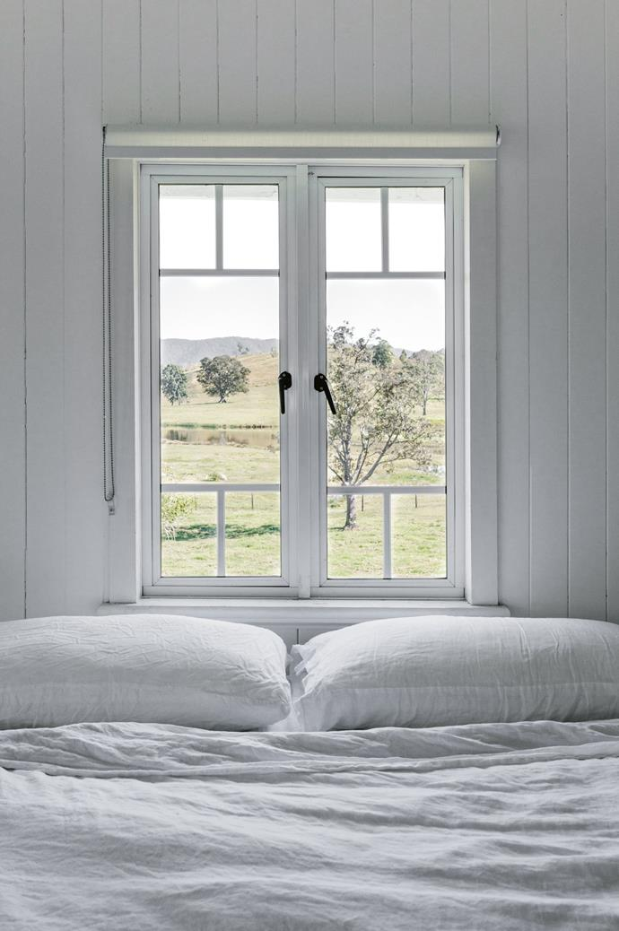 The original windows were removed and replaced. Maree took colour cues from the view outside her window of her 300 grey Brahman cows and had the exterior painted white with black trim.