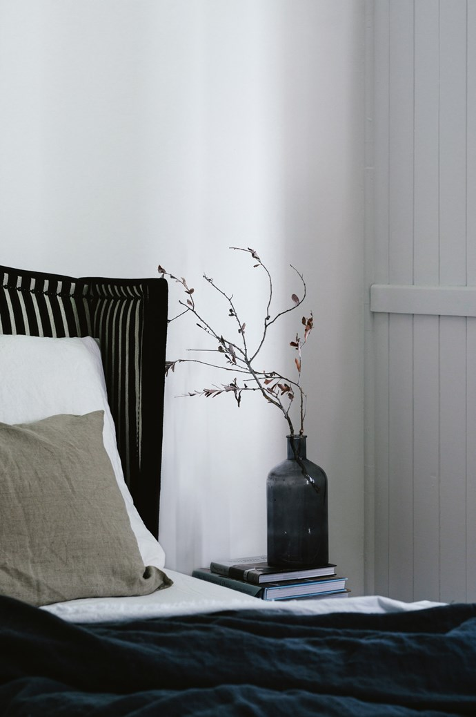 "The minimal, [monochromatic palette](https://www.homestolove.com.au/monochrome-interiors-trending-on-pinterest-6871|target=""_blank"") of the main bedroom."