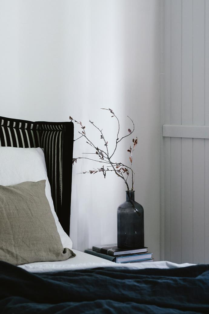 "The minimal, [monochromatic palette](https://www.homestolove.com.au/monochrome-interiors-trending-on-pinterest-6871|target=""_blank"") of the main bedroom."