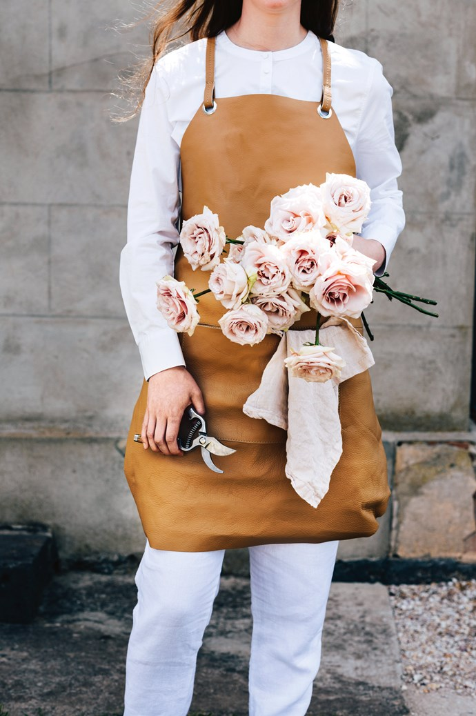 'Talo' apron, $169, and shirt, $139, both from [Country Road](https://www.countryroad.com.au/). 'Basix' linen napkin, $22, from [Hale Mercantile Co.](https://halemercantilecolinen.com/) Secateurs, $39, from [Scout House](https://www.scouthouse.com.au/).   Photo: Lauren Bamford