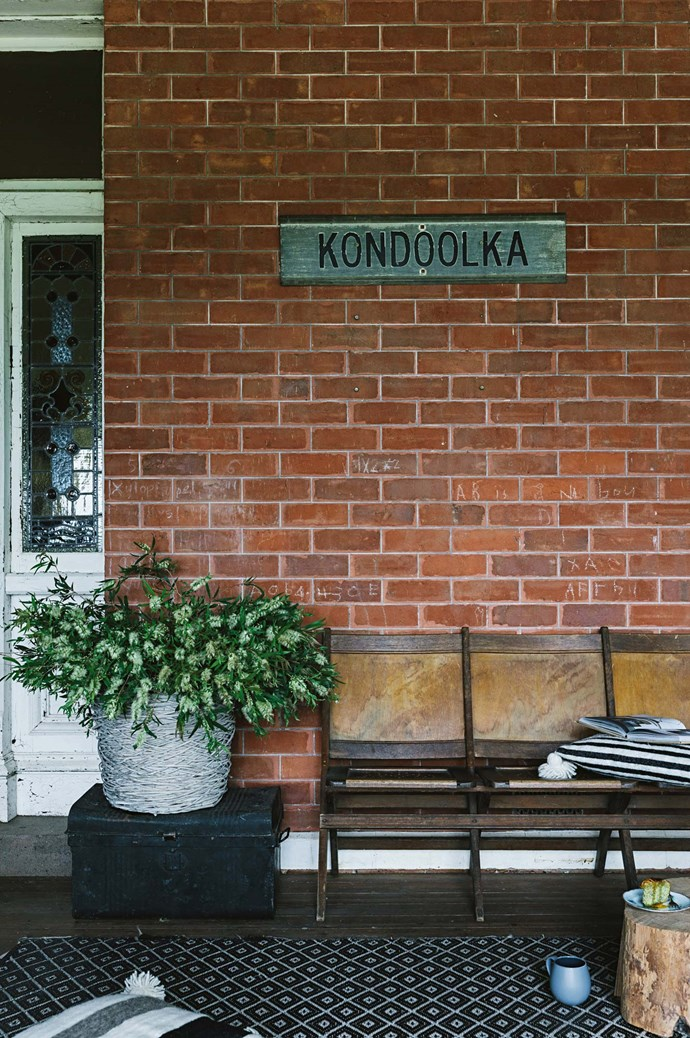 "Old theatre seats sit under the Kondoolka sign, the farming property where Paul grew up. Both he and Megan were raised in the countryside, and this Victorian homestead reminded them of ""that familiar feeling, the same smell that old country homes can have.""  