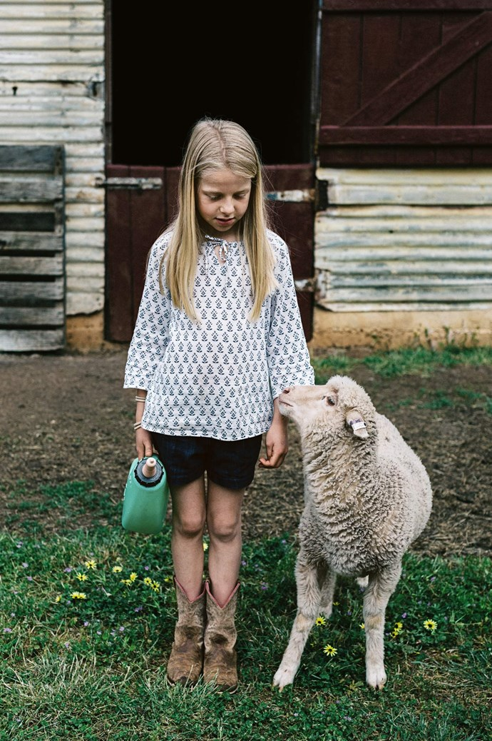 Millie out with Nibbles the lamb.  | Photo: Marnie Hawson