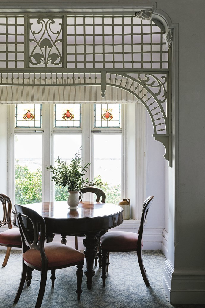 "Ornate fretwork arches above a round table that was given to the family by Megan's cousin. ""I love having a revolving collection of furniture going through my house, changing it around, putting it in different rooms, and then something else will come along for a few days or weeks.""  