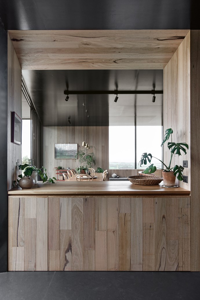 Inspired by the Rose Seidler house in Sydney, a large servery in the kitchen gives visual access to the living areas and the view beyond.    | Photo: Ben Hosking