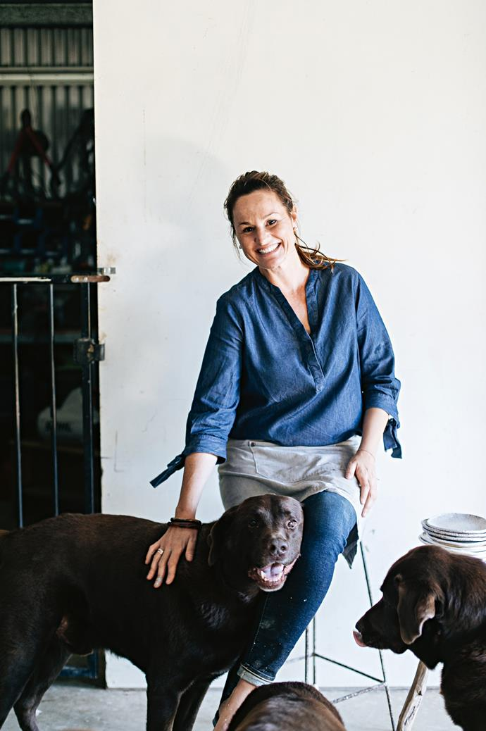 Anna with her chocolate Labradors Oskar, Cleo and Buster.