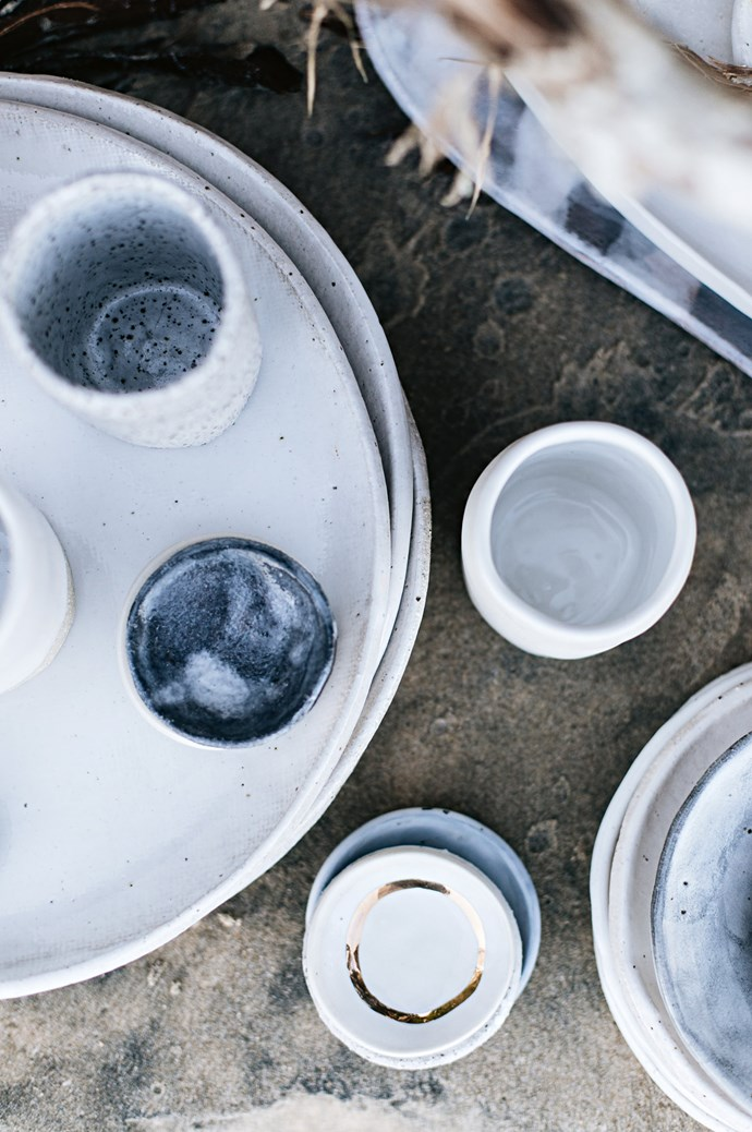 Plates and tapas bowls from the 'Granite' collection feature soft grey and white washes.