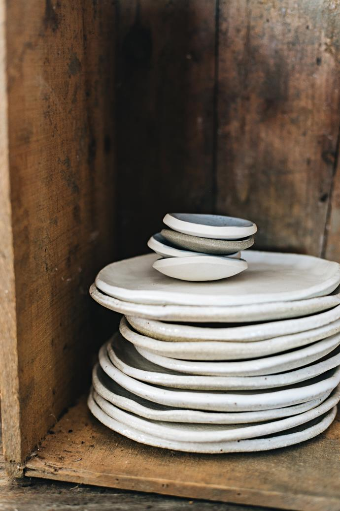 A stack of handmade side plates and condiment dishes ready to be packed and shipped to a lucky customer.