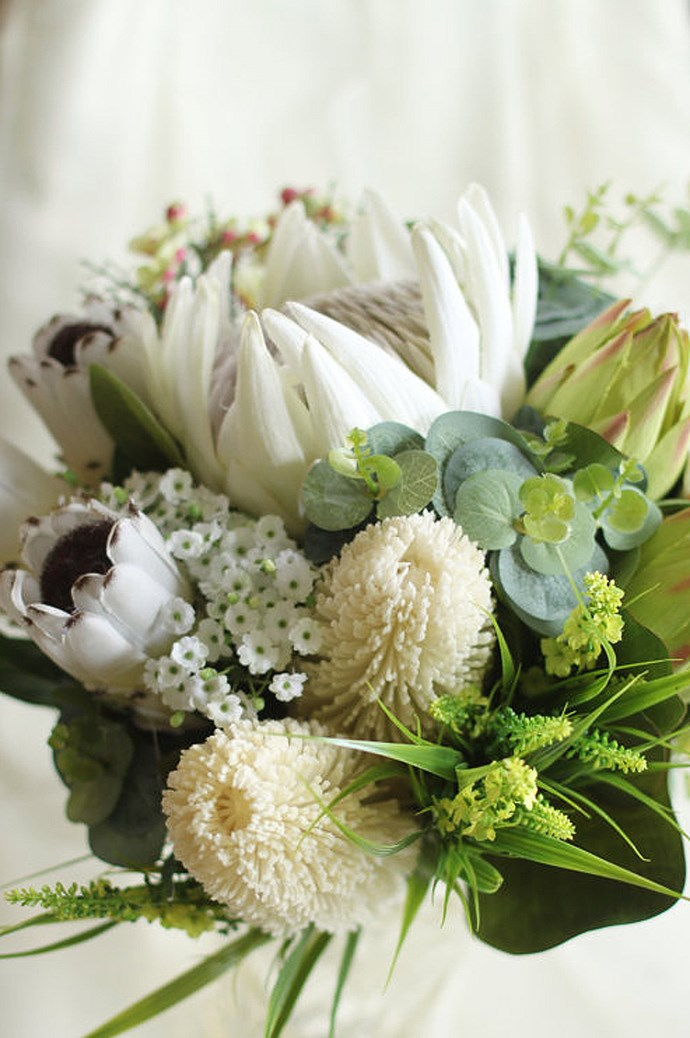 7\. White proteas. Proteas come in many colours and varieties — we love these blooms mixed with creamy white banksia, Geraldton wax and gums. Image courtesy of [La Plume de Fleur](https://www.etsy.com/au/shop/LaPlumeDeFleur?ref=l2-shopheader-name).