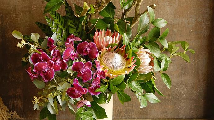 1\. Proteas, orchids and eucalyptus leaves. Protea flowers last for a long time and orchids are icons of beauty, while eucalyptus leaves symbolise healing and protection. Image courtesy of [Buds & Bowers](https://budsandbowers.com/).