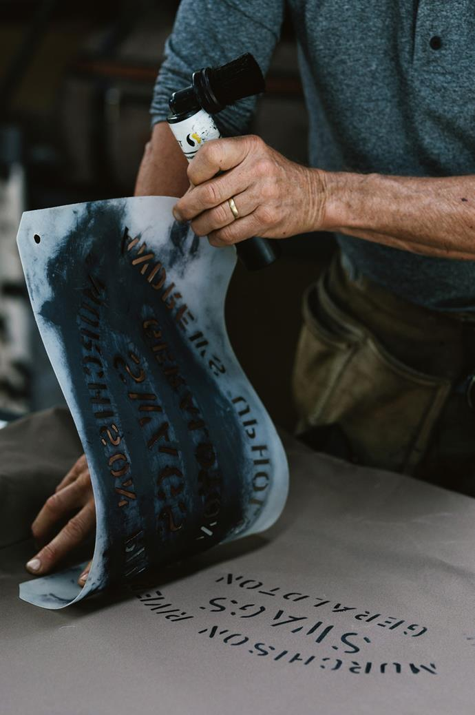 As well as stencilling on the swags, the couple sew leather tags onto each product.