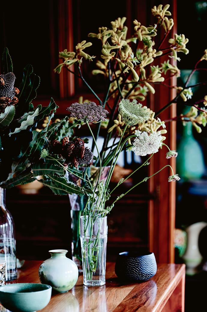 Flowers in the kitchen add a fresh touch to the home's weathered aesthetic.