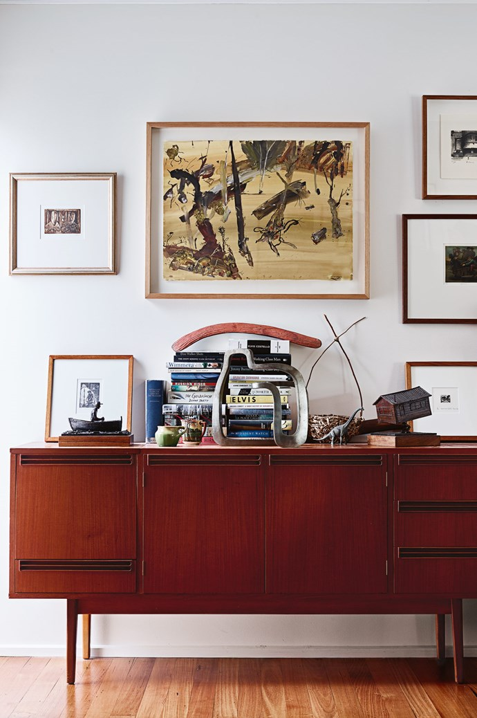 Much of David's art collection comes from swaps with other artists. A work by [John R. Walker](https://johnrwalker.com.au/) is centred above a Danish-style bureau David bought on eBay. The other works are also by friends including [Pro Hart](https://www.prohart.com.au/), [Rick Amor](http://www.rickamor.com.au/) and [Geoffrey Ricardo](http://www.geoffreyricardo.com/). David made the two bronze sculptures, while his wife Sarah made the basket. The large sculptural piece is by [Jamieson Miller](http://www.jamiesonmiller.com/).