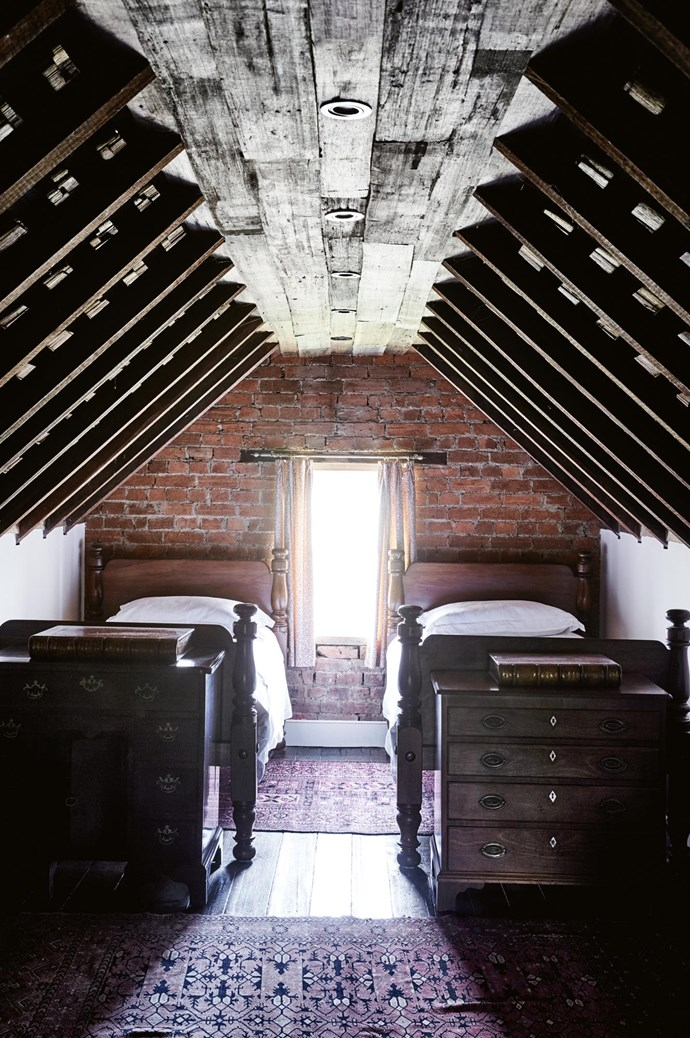 "The attic at Nile Farm still has the original exposed shingles under the roof. The Westmores [transformed the former storage space into a bedroom](https://www.homestolove.com.au/before-and-after-attic-conversion-3699|target=""_blank""). The old pit-sawn floorboards that run through the rest of the house were damaged in the attic and covered with recycled wood palings."