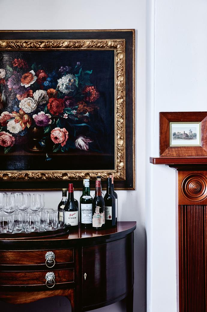 A painting in the manner of Dutch master Rachel Ruysch hangs above a console in the dining room. Carol, vice-president of Launceston's Queen Victoria Museum and Art Gallery Foundation, regards Tasmania as a great place to view colonial art.