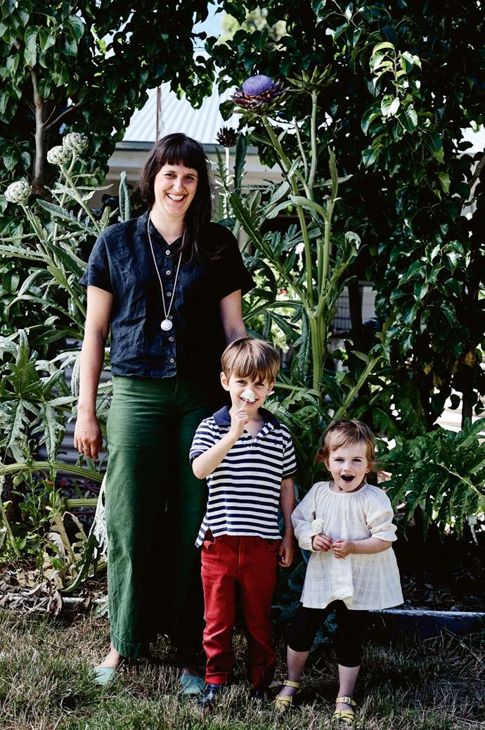 Elizabeth with Archer and Beatrice in the garden.