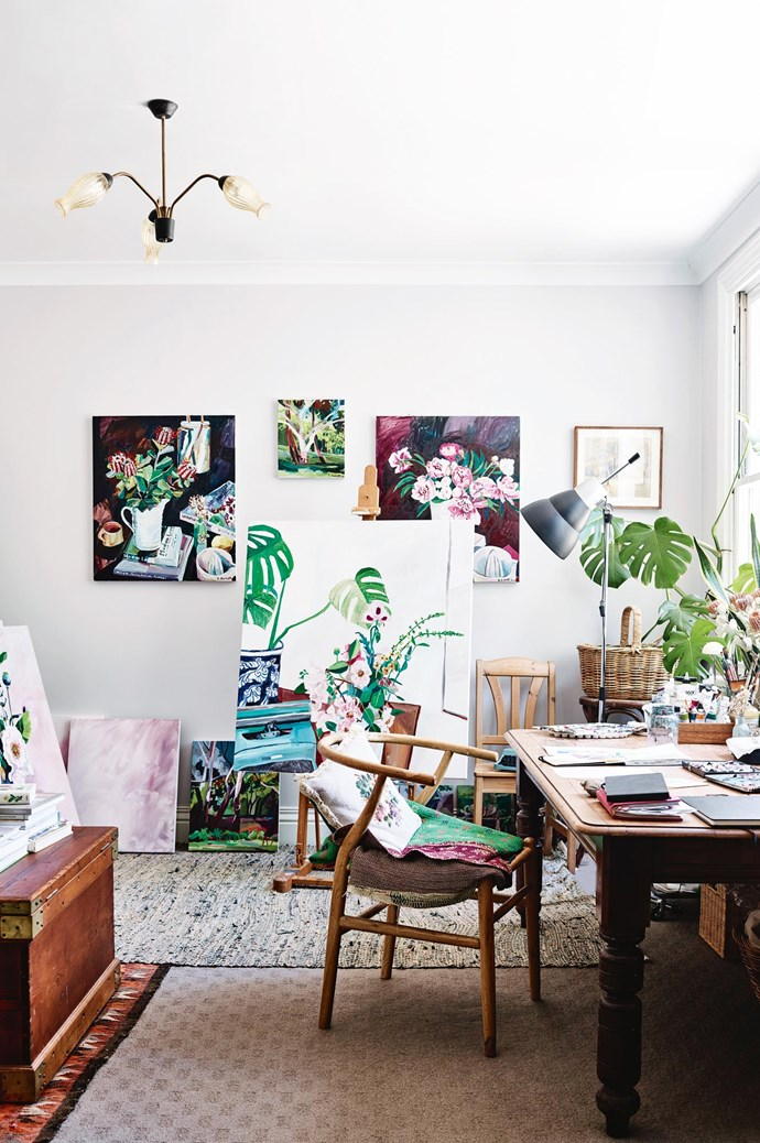 The artist's studio is full of finished pieces and works in progress. On the left, 'Banksias, Modern Love and WInifred' is a commissioned piece, while the large painting at the centre is still in progress. The landscape behind 'Looking down the paddock' and 'Springhill Peonies' (back right) will be featured in an upcoming exhibition.  | Photo: Mark Roper