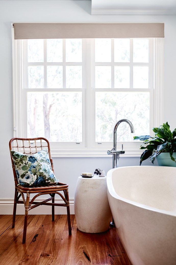 The main  bathroom looks out to the garden. The cushion on the cane chair is Elizabeth's design.