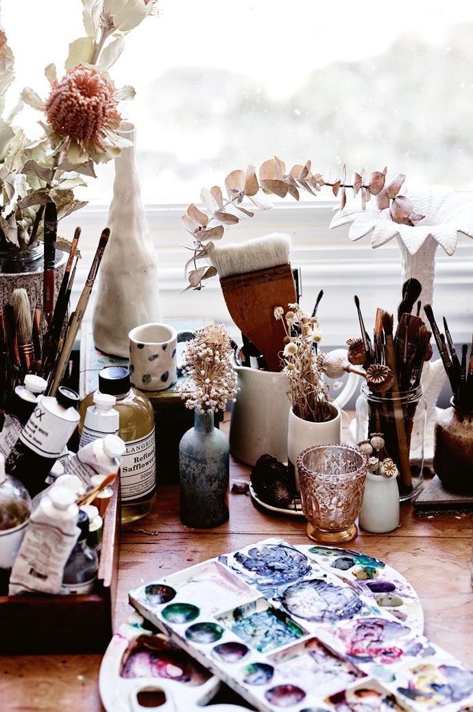 "Elizabeth 's desk is scattered with sources of inspiration. ""I'm a bower bird,"" she says."