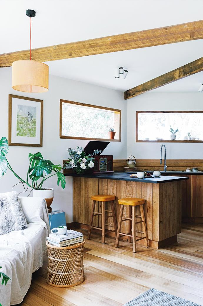 "The home's open-plan layout is flooded with natural light — accommodating all the foliage that Brigitte drags in from outside. The kitchen bar stools were an [op-shop find](https://www.homestolove.com.au/why-you-should-op-shop-5666|target=""_blank"") from Bruny Island and the artwork is Brigitte's own piece, 'Wolf in the Meadows'."
