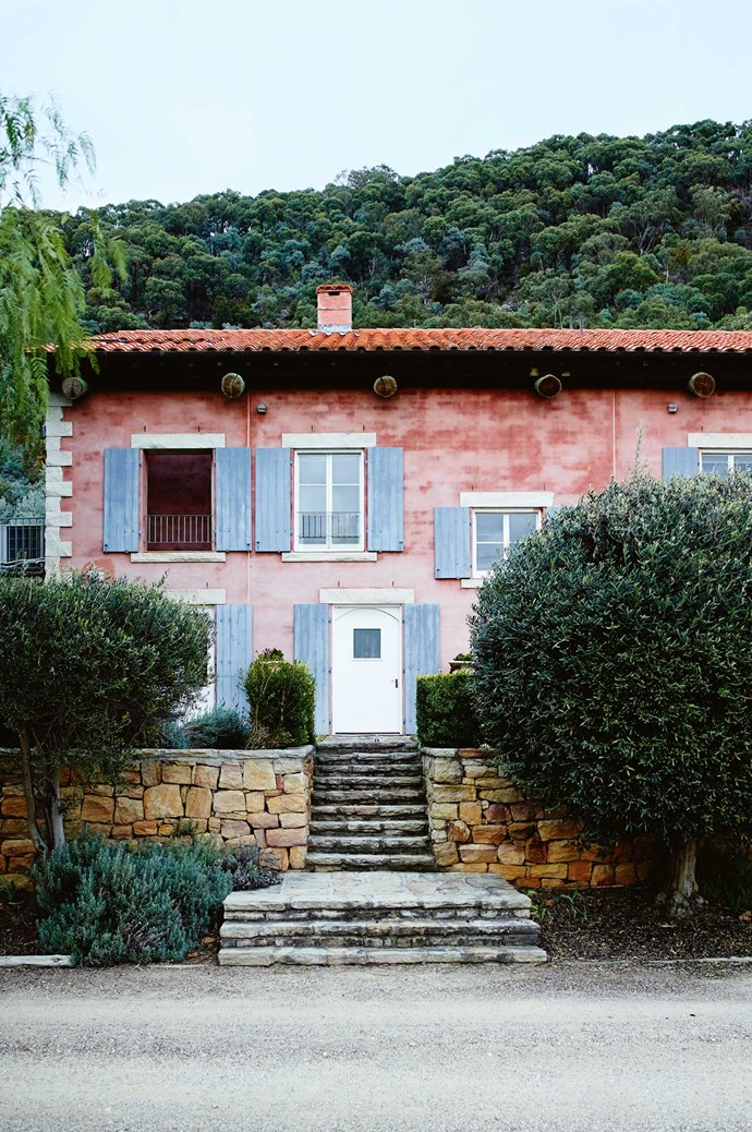 Designed byFrench architects, the rosy facade of Talits Estate incorporates rustic Provençal touches such as stonework and timber window shutters. | Photo: Mark Roper