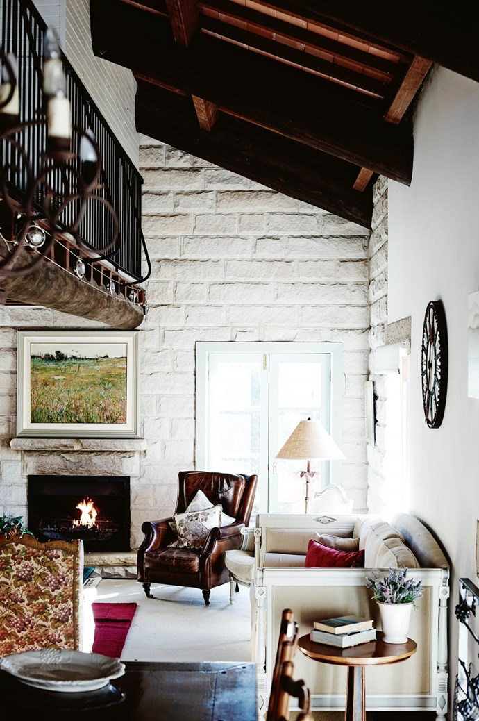 With its European materials and furnishings, the property exudes a casual elegance best enjoyed fireside with a glass ofred. | Photo: Mark Roper