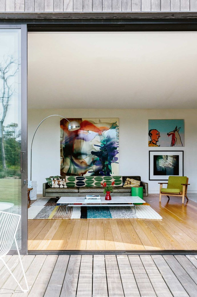 In Imogen's Mornington Peninsula home, artworks by Dale Frank and Adam Cullen add colour to the living area.    Photo: Marnie Hawson