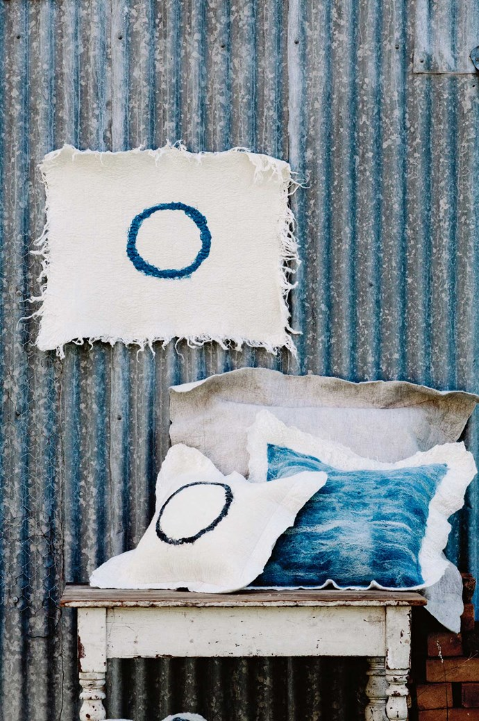 """""""Buy quality over quantity; investing in something you truly love is infinitely more rewarding than a cheap fix,"""" says Imogen. Pictured, a selection of Grace's cushion covers, including the 'Black Ring' and 'Blue Lace' styles.  