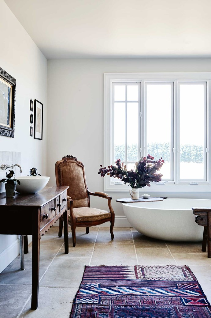 In the bathroom, a 'Rodney' tub and round concrete basin from [Boyd Alternatives](http://www.boydalternatives.com.au/) feature alongside a chair from [Found. at Hepburn](https://found.style/). The antique vanity is complemented by tapware from [The English Tapware Company](https://www.englishtapware.com.au/). | Photo: Mark Roper