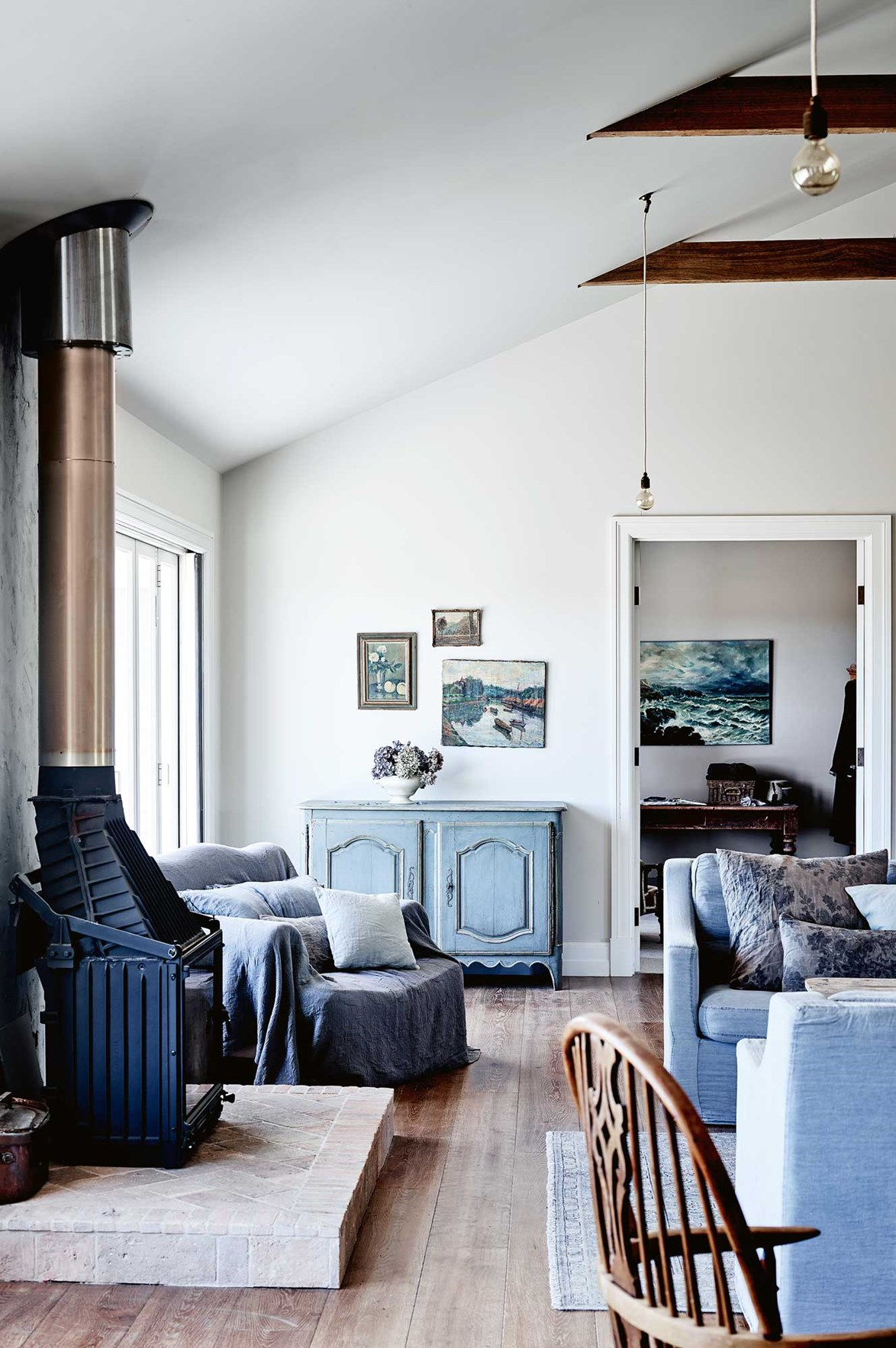"Upcycled timber furniture and collected artworks add colour and character to this farmhouse in the [Macedon Ranges](https://www.homestolove.com.au/share-house-a-family-farmhouse-in-the-macedon-ranges-14014|target=""_blank"")"