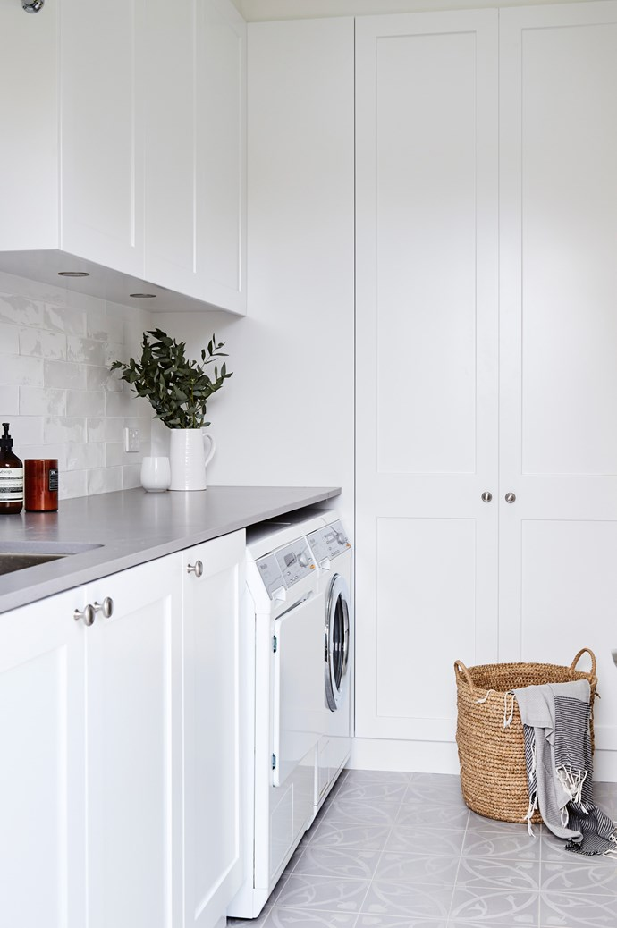 2. Functioning as a double-duty beauty, this minimalist laundry also works as a butler's pantry of sorts, connecting to the kitchen and primed for its home owners to entertain guests.  | Photo: Sue Stubbs