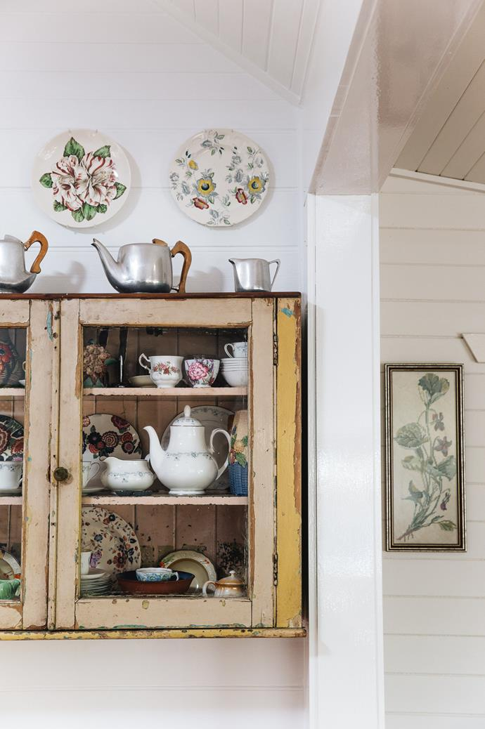 Family heirlooms sit in a vintage cabinet.
