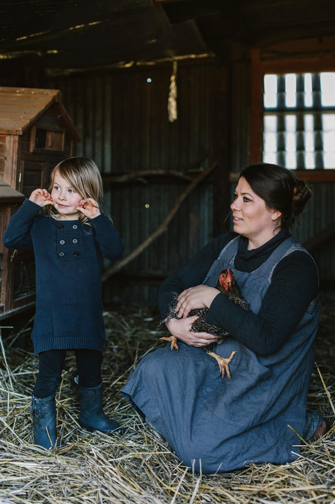 Ilona spends time on the farm with Lottie and a feathered friend.