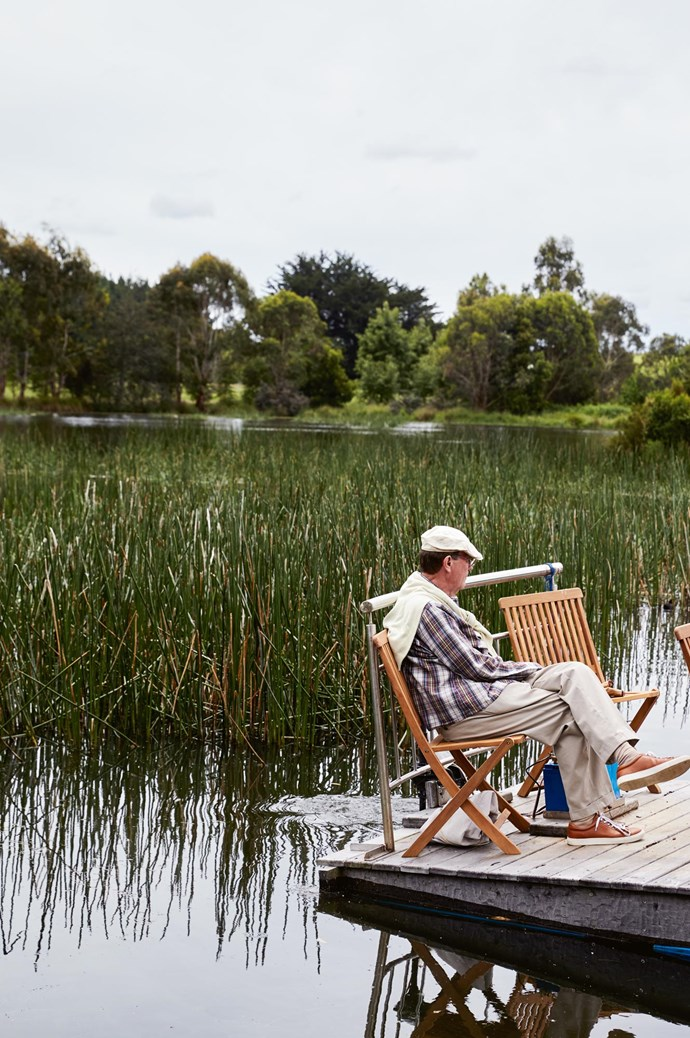 Tom relaxes on the pontoon boat, which he uses to reach Etoline's Island.